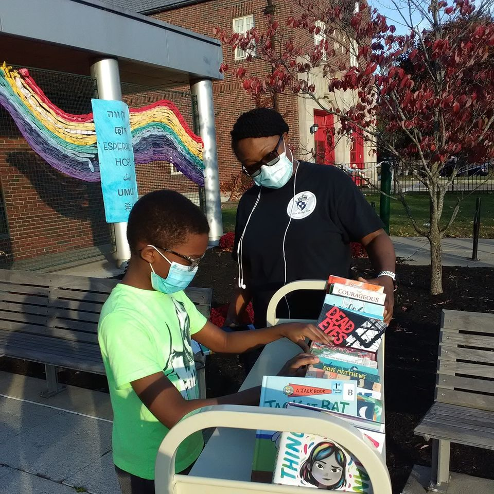 Patrons enjoying an outside pop-up library.